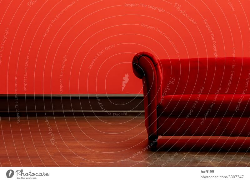 Partial view of a red sofa in a red room Furniture Sofa Living room Exceptional Elegant Uniqueness Retro Warmth Red Black Enthusiasm Warm-heartedness Eroticism
