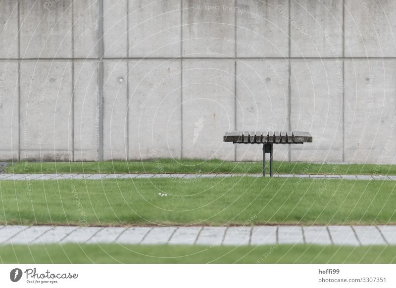 minimalistic view of a bench with lawn in front of a concrete wall Grass Lawn Building Wall (barrier) Wall (building) Bench Park bench Concrete Wood Line Wait