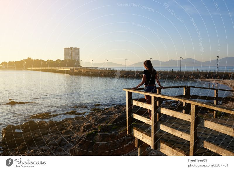 Young woman contemplating the sea Summer Beach Ocean Island Feminine Youth (Young adults) 1 Human being 18 - 30 years Adults Nature Landscape Sand Clouds