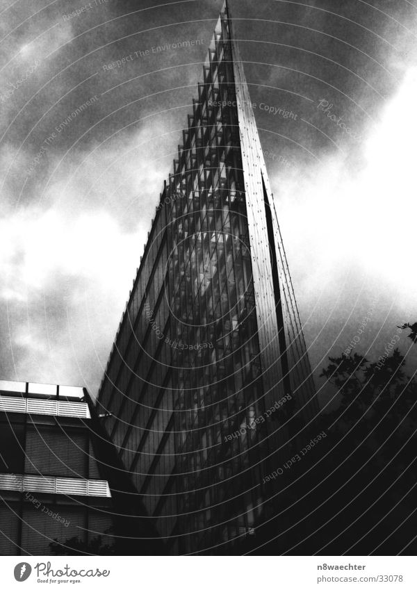Modern Office High-rise Triangle Steel Grid Black White Dark Clouds Gritty Flat Architecture building Glass Shadow Black & white photo Berlin annexes Tall
