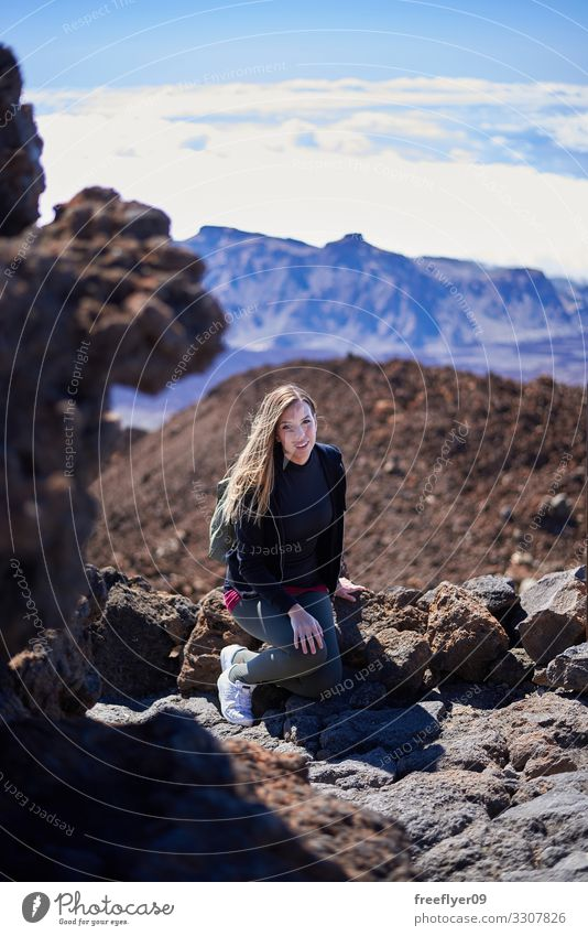 Young woman sitting on the Teide Volcano Beautiful Athletic Relaxation Vacation & Travel Tourism Trip Adventure Freedom Sightseeing Island Mountain Hiking