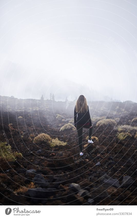 Young woman contemplating the fog Lifestyle Tourism Hiking Human being Youth (Young adults) Woman Adults 1 18 - 30 years Nature Landscape Clouds Fog Rain Rock