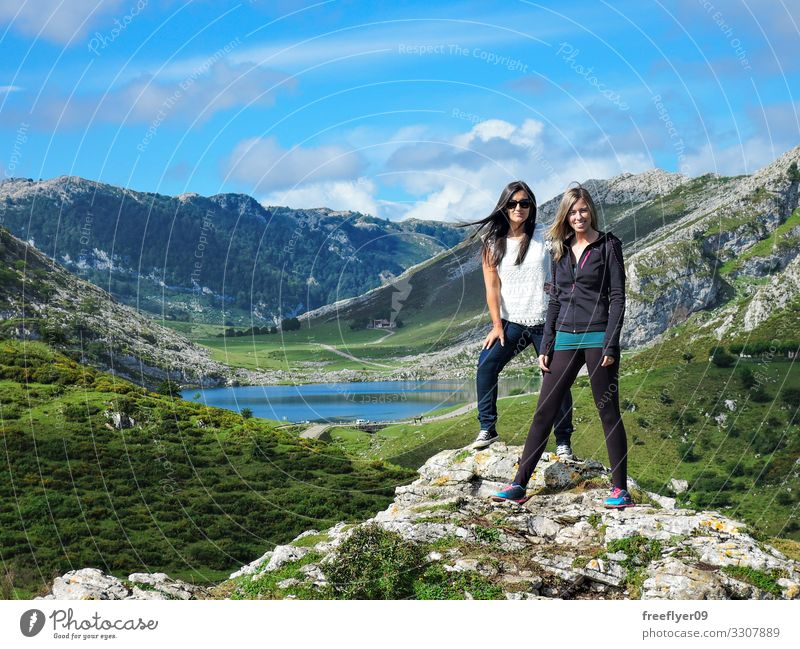 Two friends in front of Covadonga Lagoon Woman Human being Sky Nature Youth (Young adults) Young woman Blue Beautiful Green Landscape Mountain 18 - 30 years