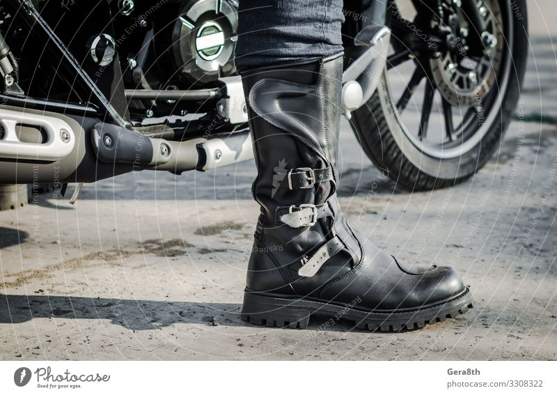 biker leg in a boot against the backdrop of a motorcycle Human being Legs Feet 1 Transport Street Vehicle Motorcycle Leather Footwear Gray Black Motorcycling