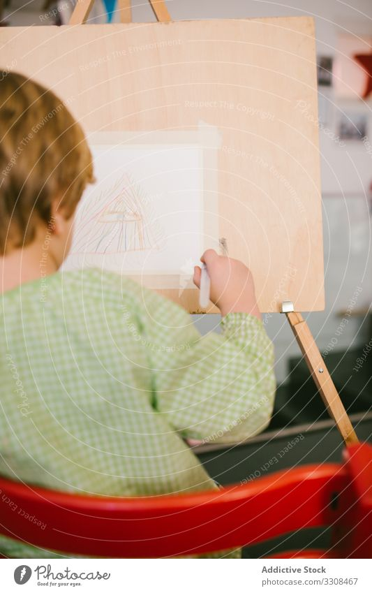 Kid drawing on canvas at home child picture kid boy art serious calm paint hobby peaceful casual house childhood apartment flat creative free time relax day