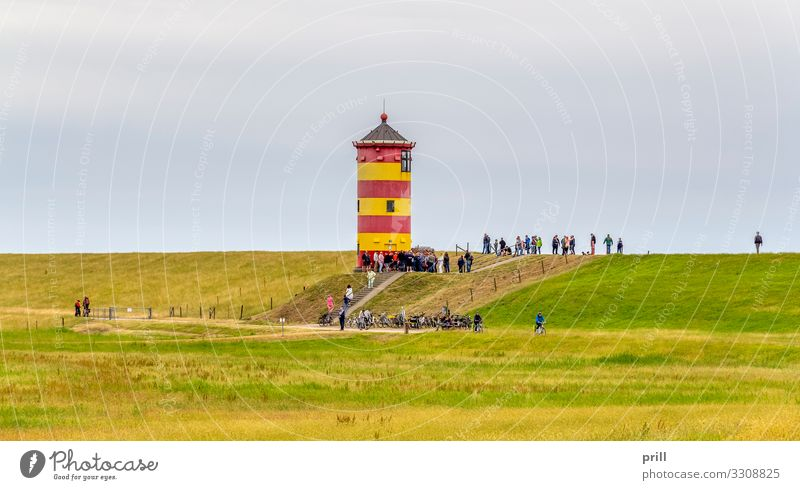 Pilsum Lighthouse Tourism Grass Meadow Coast Tower Landmark Yellow Red Pilsum lighthouse Beacon Dike East Frisland Friesland district Northern Germany