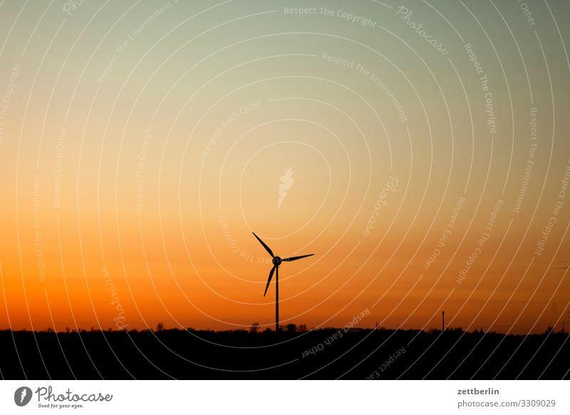 Wind turbine in the evening Village Twilight Far-off places Horizon Landscape Mecklenburg-Western Pomerania Deserted Baltic Sea Baltic island Rügen Sun Sunset