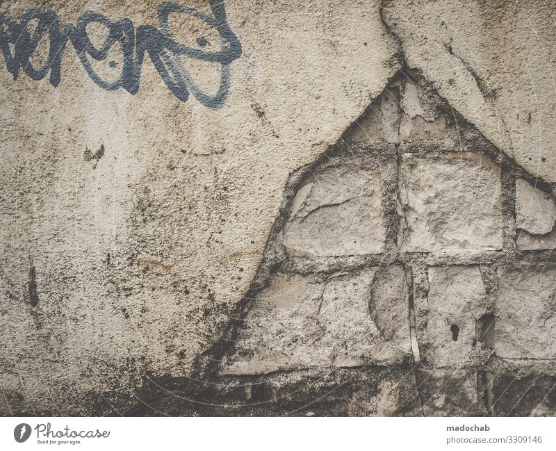 pyramid Manmade structures Wall (barrier) Wall (building) Facade Sign Characters Graffiti Broken Trashy Dry Town Decline Past Transience Colour photo