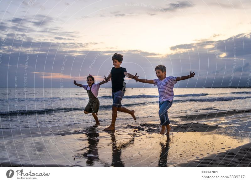 Three kids running on the beach at sunset Child Human being Sky Vacation & Travel Youth (Young adults) Summer Beautiful Water Landscape Sun Ocean Relaxation Joy