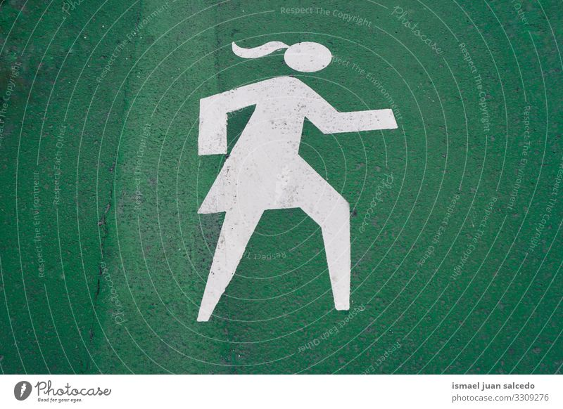 pedestrian woman road sign on the green road in Bilbao city Spain walker traffic signal warning street symbol way caution roadsign advice safety outdoors bilbao