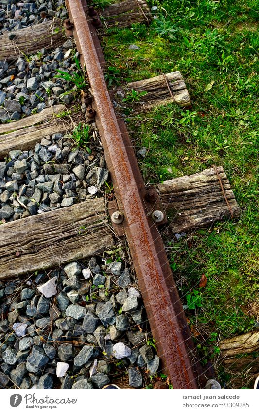 old abandoned railroad track in the station railway railway line train tracks transportation travel industry lane metal metallic infrastructure stone iron