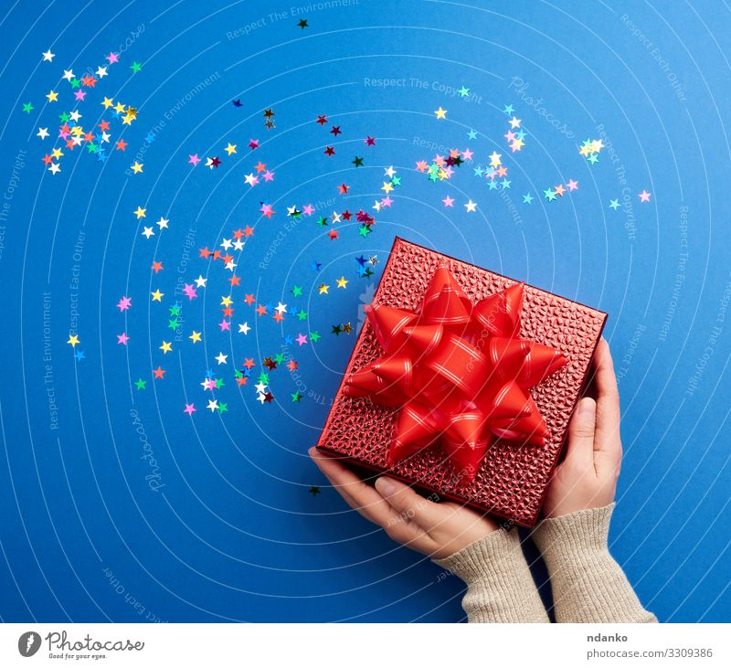 beautiful shiny red box with a big red bow Woman Christmas & Advent Blue Colour Red Hand Adults Feasts & Celebrations Above Design Decoration Gold Glittering