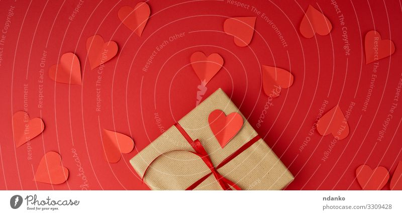 square box wrapped in brown kraft paper Red Love Feasts & Celebrations Brown Above Design Decoration Birthday Table Heart Gift Shopping Paper String Simple
