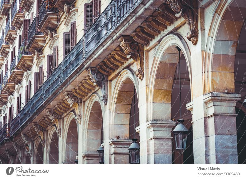 Arcades of a residential building Town Capital city Manmade structures Building Architecture Facade Balcony Terrace Window Stone Concrete Metal Steel Old