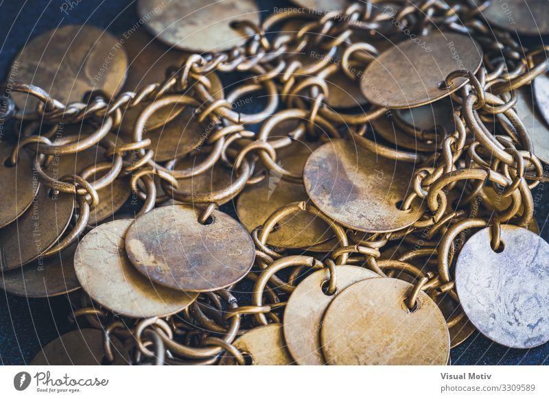 Close-up of a boho style bracelet with golden circular small discs Work of art Metal Ornament Esthetic Authentic Hip & trendy Beautiful Original Design