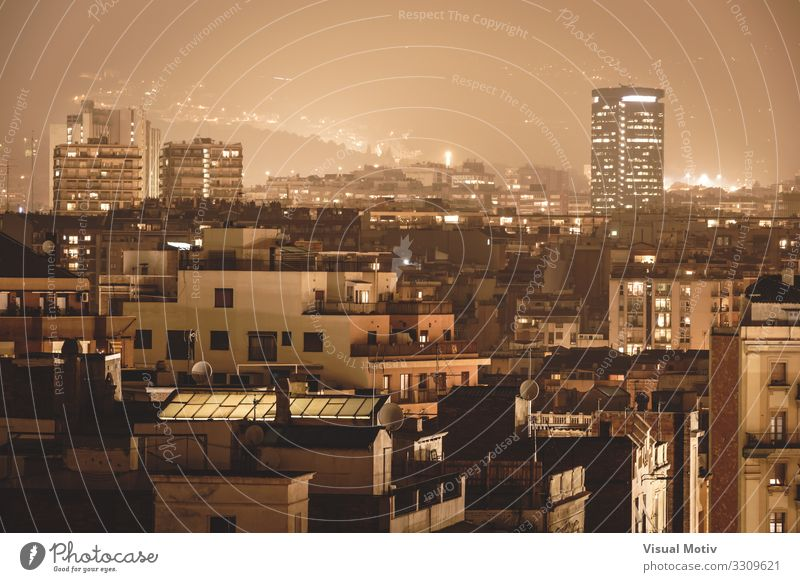 Buildings under the city lights surrounded by a foggy atmosphere Town Capital city Port City Skyline Populated Manmade structures Architecture Window Facade