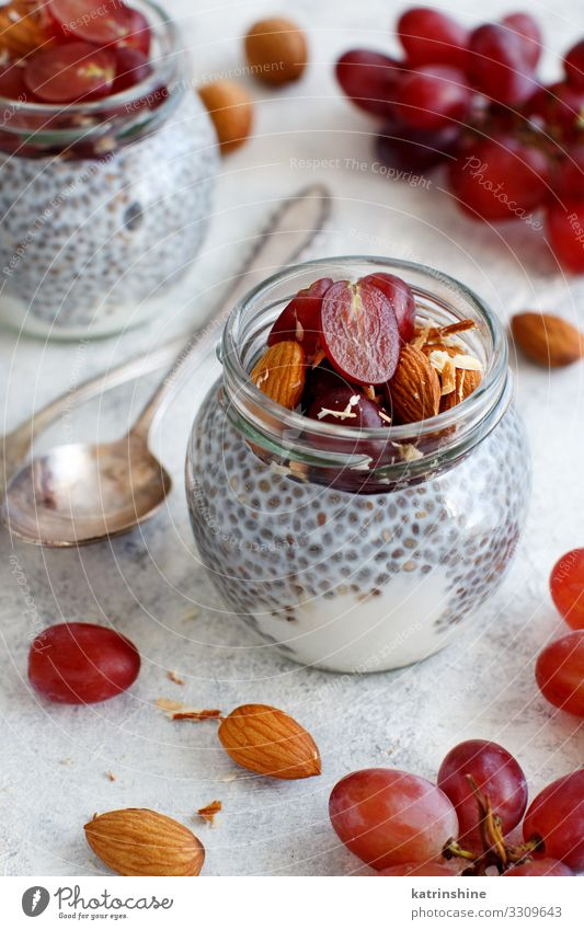 Chia pudding parfait with red grapes and almonds White Eating Fruit Dessert Breakfast Diet Meal Rustic Home-made Raw Spoon Organic Bunch of grapes Yoghurt Dairy