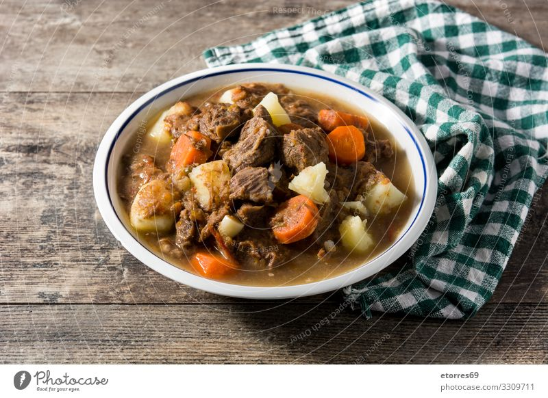 Irish beef stew with carrots and potatoes Healthy Eating Food photograph Dish Cooking Herbs and spices Tradition Plate Meat Home-made Carrot Potatoes Sauce