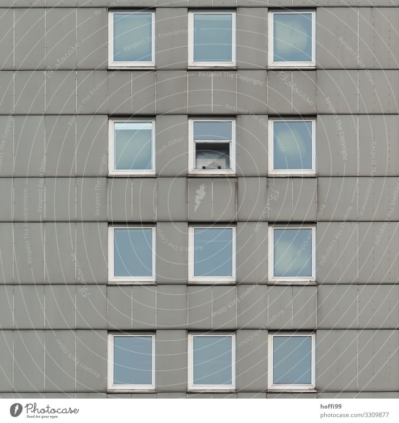 bleak high-rise facade with a half-open window House (Residential Structure) High-rise Building Facade Window Stone Glass Line Poverty Threat Cold Broken Modern