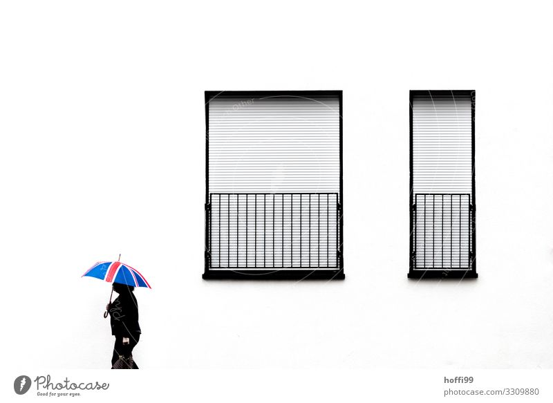 Profile of walking woman with British umbrella in front of white facade with closed windows, synonym Brexit Human being Feminine 1 House (Residential Structure)