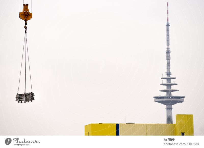 Television tower with warehouse and crane transporting a load of steel pipes Crane Industry Tower Building Transmitting station Facade Antenna Esthetic Gigantic