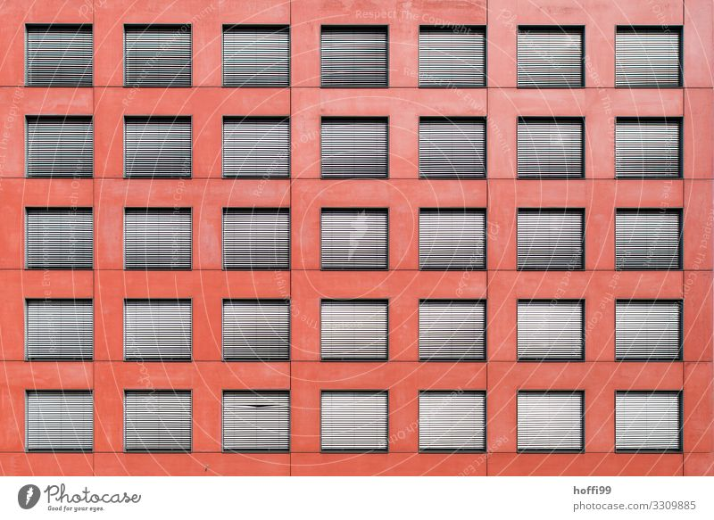 Red facade with many windows / blinds, a water tap and a bend Building Wall (barrier) Wall (building) Facade Window Venetian blinds Line Esthetic Exceptional