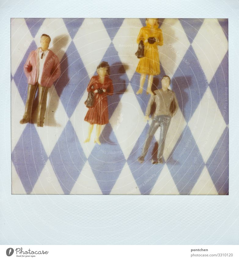 Polaroid shows toy people female and male lying on bavarian rhombus pattern Human being Masculine Feminine Woman Adults Man Couple Partner 4 Group 18 - 30 years