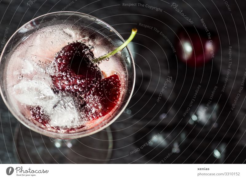 Detox drink with cherry and ice cube Fruit Cherry Ice cube Organic produce Beverage Cold drink Drinking water detox drink Glass Lifestyle Healthy Eating Bar