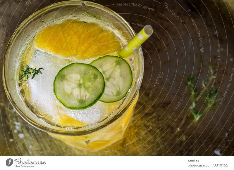 Detox drink in glass with orange, cucumber and thyme Orange Herbs and spices Cucumber Thyme Ice cube Organic produce Vegetarian diet Diet Beverage Drinking