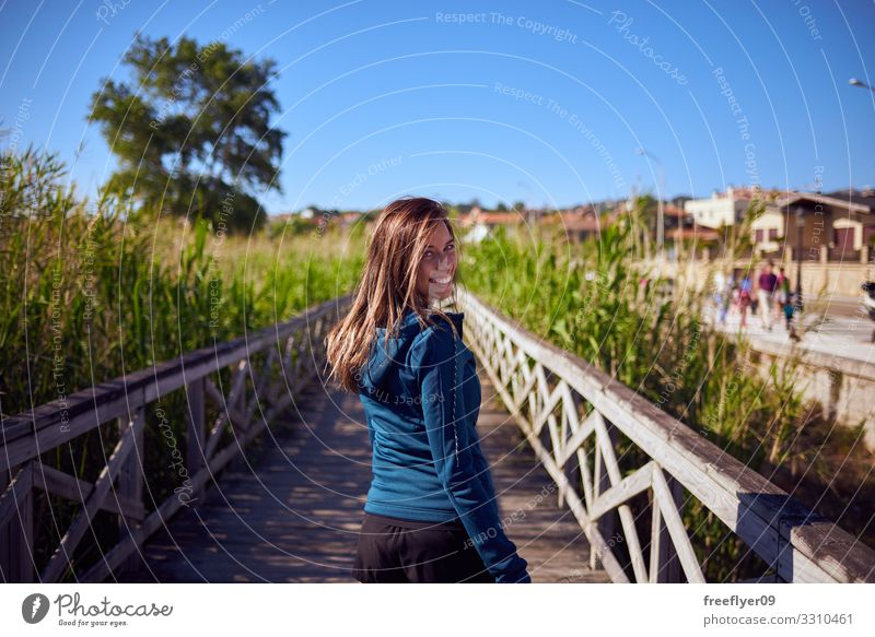 Young woman walking by a wood footbridge Lifestyle Relaxation Hiking Vacation & Travel Tourism Adventure Freedom Summer Youth (Young adults) Woman Adults 1