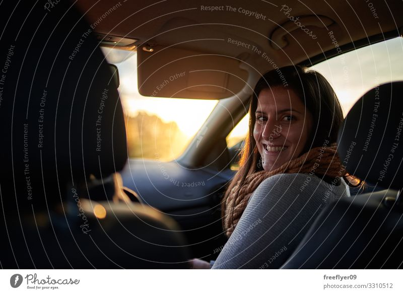 Portrait of a young woman on the frontseat of a car Joy Happy Beautiful Vacation & Travel Industry Business Engines Human being Woman Adults Man