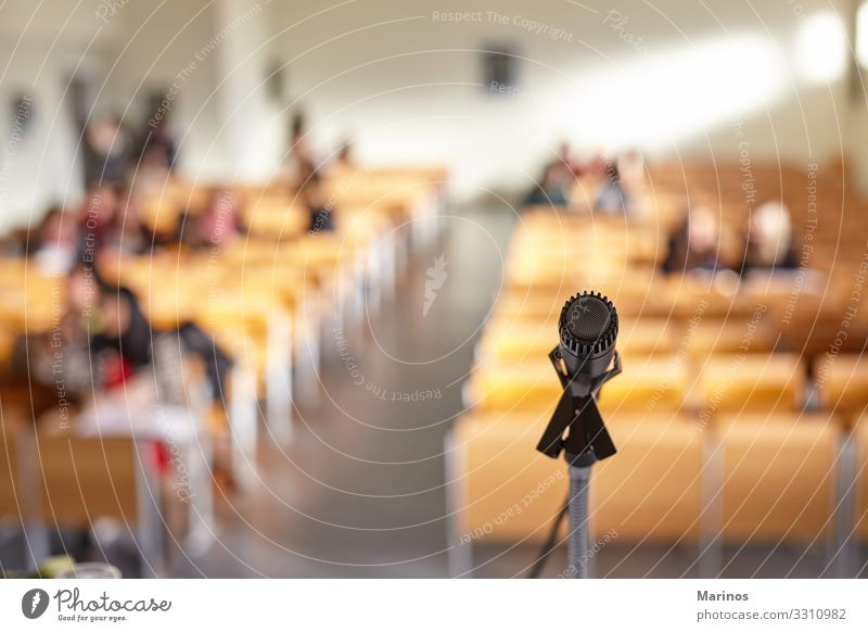 Closeup view of microphone in university teaching room. Table Audience Adult Education Business Meeting Media Church Performance Conference Microphone Public