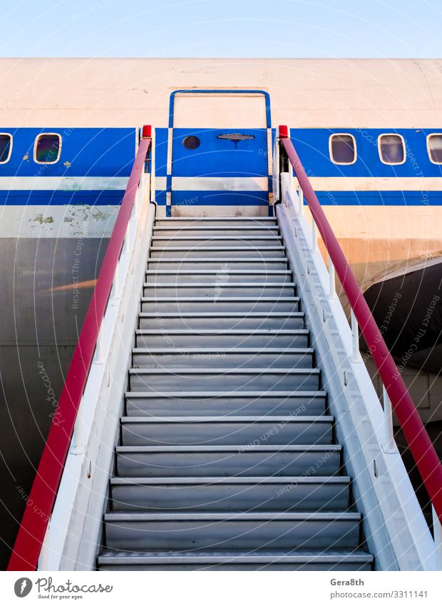 gangway of an old civilian airliner Vacation & Travel Aviation Transport Porthole Airplane Passenger plane Metal Steel Old Retro Speed Blue Red Colour door