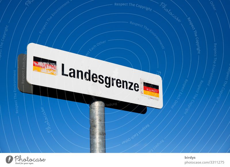 Sign National border Germany in front of a blue sky, on a pedestrian path in the border area Germany - Switzerland Cloudless sky Climate change