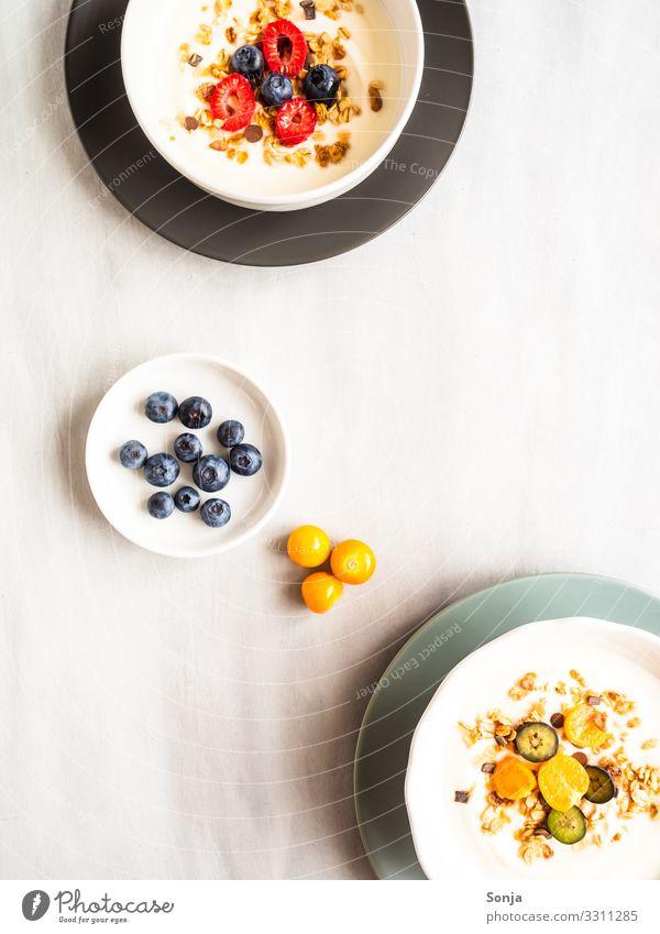Healthy breakfast with yoghurt, muesli and fruit Food Yoghurt Fruit Raspberry Blueberry Physalis Cereal Nutrition Breakfast Organic produce Vegetarian diet Diet