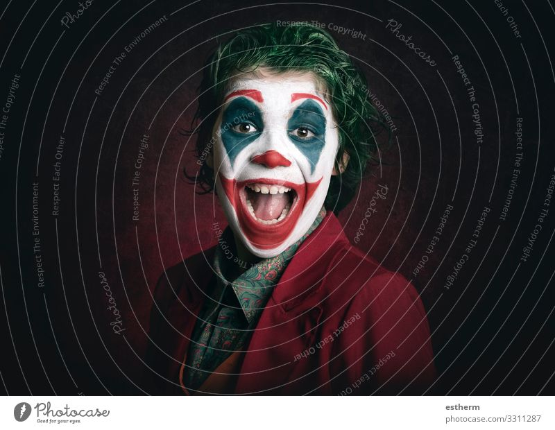 smiling boy dressed as Joker Child Human being Joy Lifestyle Funny Laughter Feasts & Celebrations Playing Party Fear Masculine Smiling Infancy Happiness Crazy