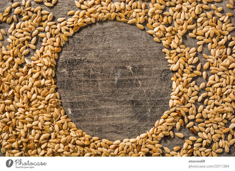 Golden flax seeds on wooden table. Copy space Healthy Eating White Food photograph Wood Yellow Exceptional Agriculture Dry Good Grain Vegetarian diet Diet Bowl