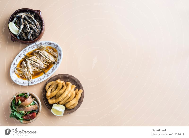 Mixed of fish ( cuttlefish, sardines, fried, salad with salmon) Seafood Lunch Dinner Plate Ocean Restaurant Fresh Delicious White Tradition anchovy appetizer