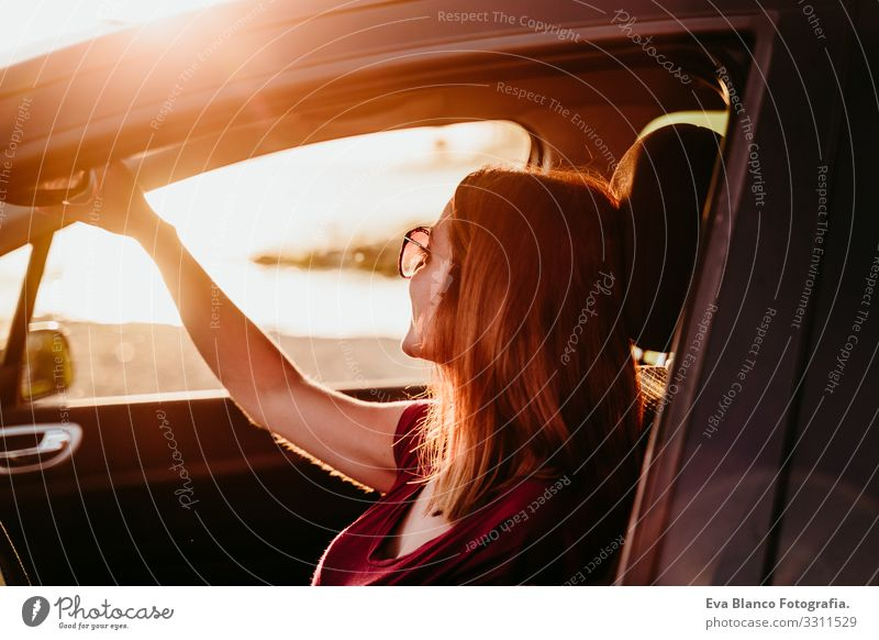 young woman driving a car at sunset. travel concept Youth (Young adults) Woman Car Driving Sunset Beach Driver Vacation & Travel Traveling Trip Lifestyle