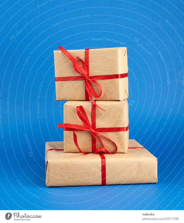 stack of boxes wrapped in brown paper Christmas & Advent Blue Colour Red Yellow Natural Feasts & Celebrations Brown Design Decoration Birthday Gift Paper String
