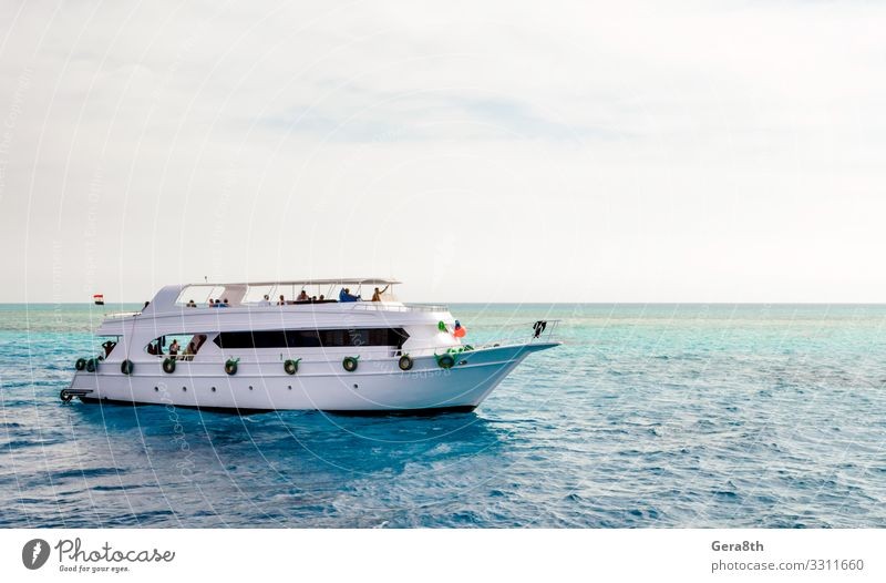white cruise tourist boat in the Red Sea in Egypt Vacation & Travel Tourism Cruise Beach Ocean Entertainment Dive Nature Landscape Sky Clouds Horizon