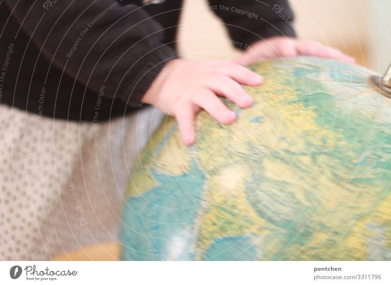 Toddler playing with a globe. Children's rights. Future Human being Masculine Feminine girl Boy (child) by hand Globe Touch Movement Rotate Playing Retro Round