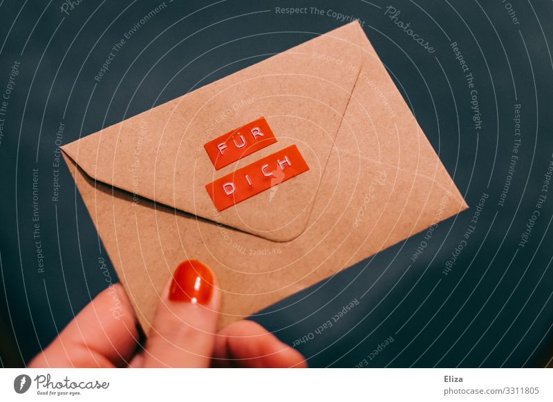 "A hand with red nail polish hands over an envelope which says ""For you Hand Blue Red Letter (Mail) Envelope (Mail) Give Donate for you Label Information"