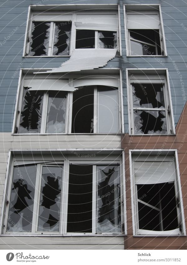 Destroyed façade of a panelled building with broken windows Deserted High-rise Ruin Manmade structures Building Architecture Prefab construction
