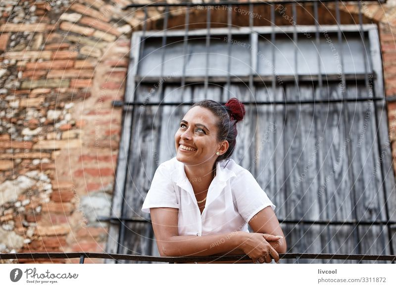 Beautiful young cuban woman leaning on a railing II Lifestyle Happy Island Human being Feminine Young woman Youth (Young adults) Woman Adults Head