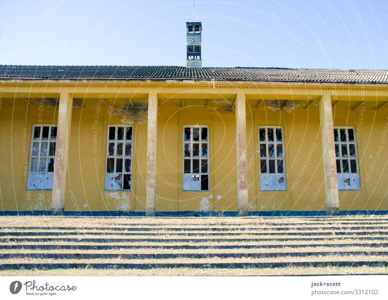 quietly lost Architecture Brandenburg Military building Sporting Complex Stairs Window Column Canopy Authentic Historic Yellow Secrecy Apocalyptic sentiment