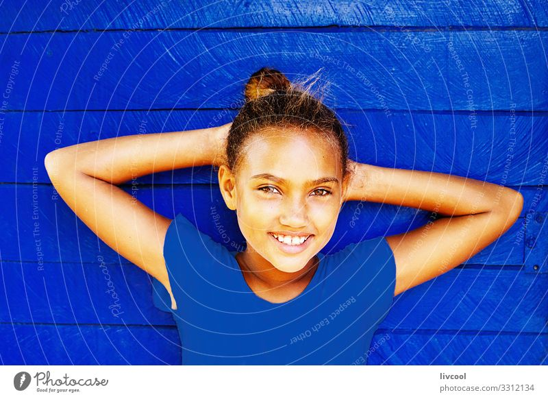 nice girl leaning on a blue pantone wall Lifestyle Style Happy Beautiful Playing Vacation & Travel Trip Island Child Human being Feminine Girl Infancy Head