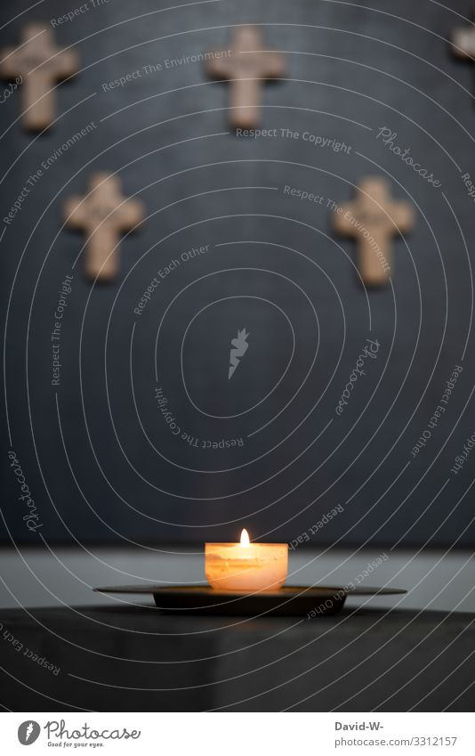 a burning candle with crosses in the background pray praying Church Faith & Religion Hope weaker believe mourn Prayer Church congress Belief Religion and faith