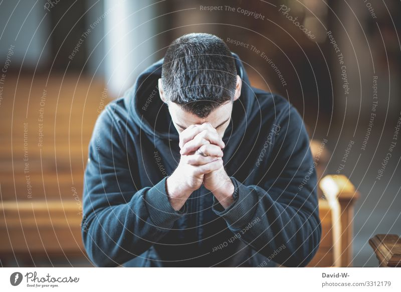 Man crouches praying in the pew Church Faith & Religion Hope weaker believe mourn praying hands Prayer Church pew Church congress Folded folded hands Belief