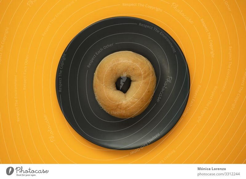 Bagel isolated on a grey plate with orange background. Top view. Dough Baked goods Bread Eating Breakfast Diet Stove & Oven Wood Fresh White Wheat Flour brunch